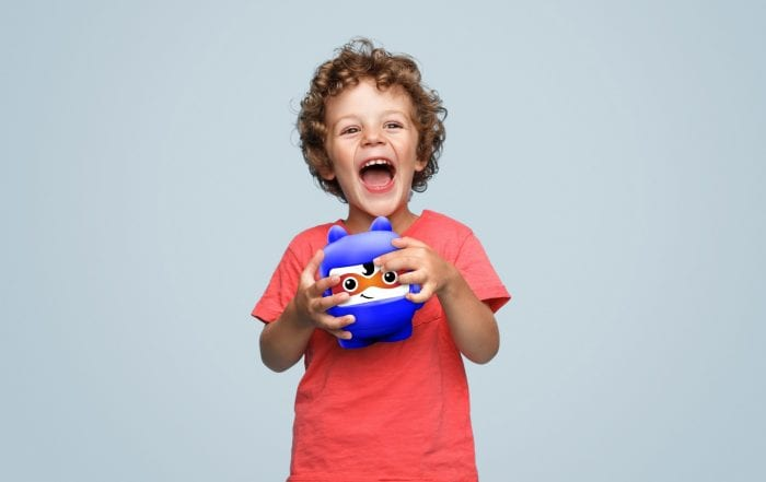 Excited boy with piggy bank Fintune